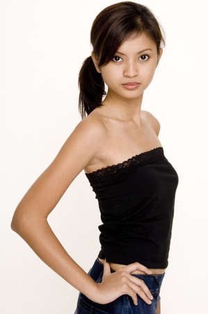 tube top: A slim and pretty young asian woman in a black tube top and denim skirt