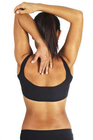 tricep: Female fitness instructor demonstrates a tricep stretch Stock Photo