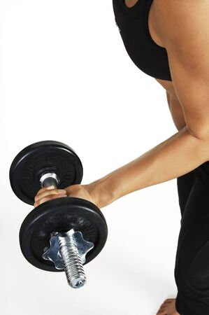 Female fitness instructor demonstrates a dumbbell curl Stock Photo - 200371