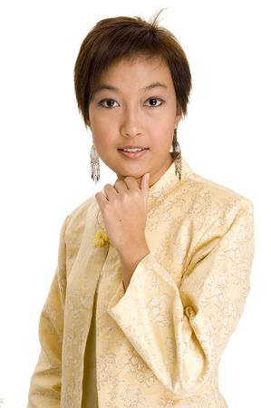 A pretty young asian woman with short hair in a yellow silk jacket Stock Photo - 221065