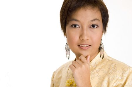 An attractive young asian woman in a yellow silk jacket photo