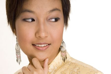 A pretty young asian woman in a yellow silk jacket looks to her left Stock Photo - 221062