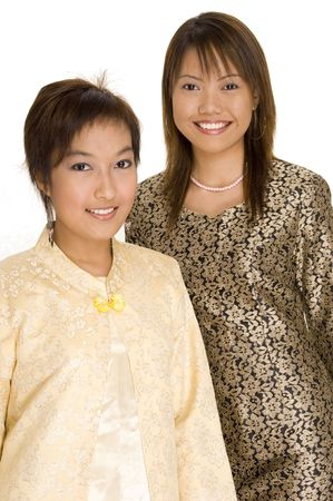 Two young asian females in different traditional dress photo