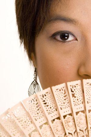 A half face shot of an asian girl holding a fan Stock Photo - 221055