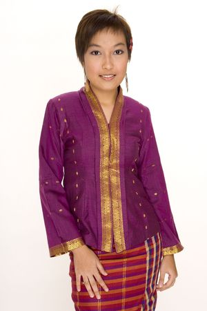 brightly: A pretty young asian girl wear brightly coloured traditional clothing