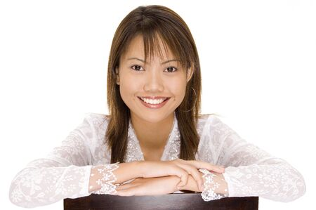 A pretty young asian girl with a gerat smile in a white silk blouse photo