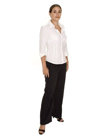pinstripe: A full-length shots of a young pretty businesswoman in pinstripe trousers and white blouse