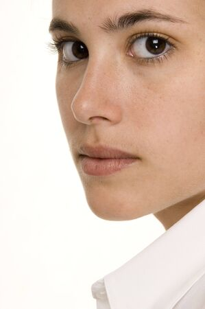 demure: A close-up of a young womans face
