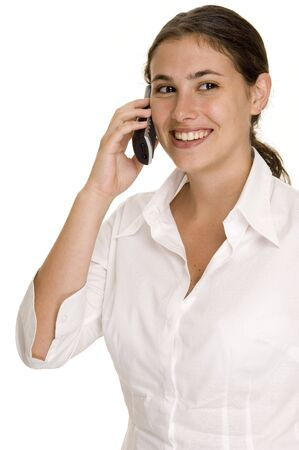 demure: A pretty young woman listens on a cordless phone Stock Photo