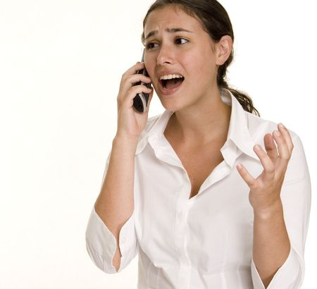 aghast: A young woman looks aghast as she talks on the phone Stock Photo