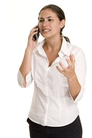demure: An attractive young woman gets frustrated by a phone call Stock Photo