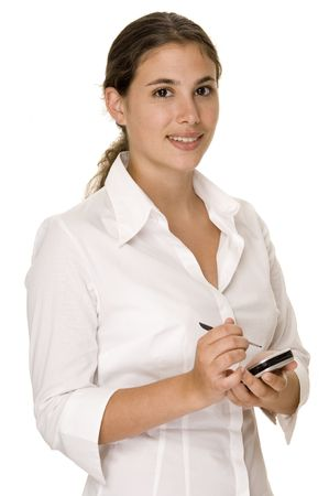 stylus: An attractive woman in a white blouse holds a PDA and stylus Stock Photo