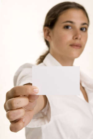 demure: An attractive young woman holds up a blank business card