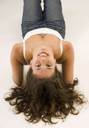 upside down: An attractive woman lets her hair down