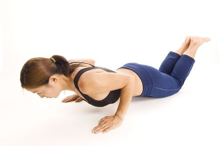 pushup: A female fitness instructor demonstrates a close-grip push-up for the triceps
