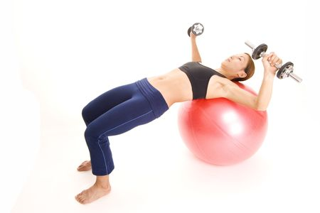 woman chest: A female fitness instructor demonstrates the starting position of the fitball dumbell press