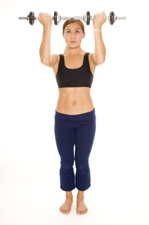 deltoids: A female fitness instuctor demonstrates the starting position of a shoulder lift