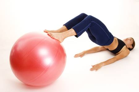 asian abs: A female fitness instructor demonstrates the starting position of the Ball Rollout Stock Photo