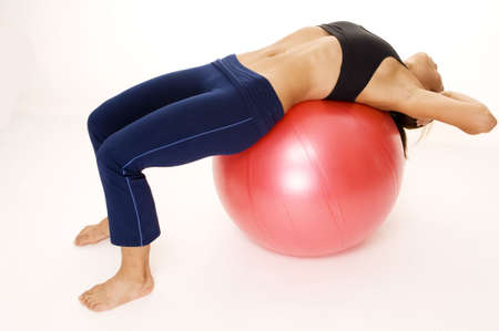 crunch: A female fitness instructor demonstrates the starting position of the 180 fitball crunch