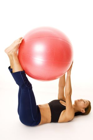 asian abs: A female fitness instructor demonstrates the starting position of the ball rock