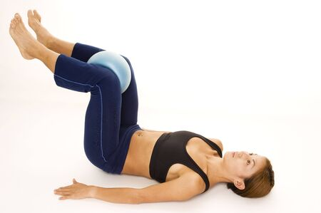 abductor: A female fitness instructor demonstrates an abductor squeeze - finish