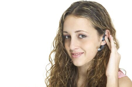 A pretty female talks on a hands-free wireless headset Stock Photo - 223781