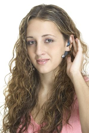 An attractive model wearing a bluetooth headset photo