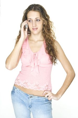 An attractive young female talks on a cellphone photo