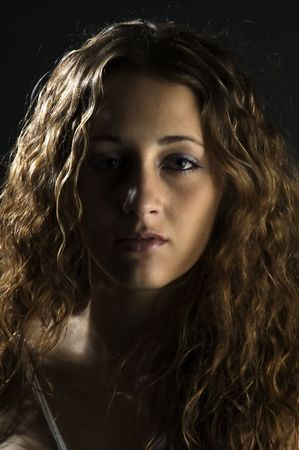 sidelight: A moody and intense portrait of an attractive young woman