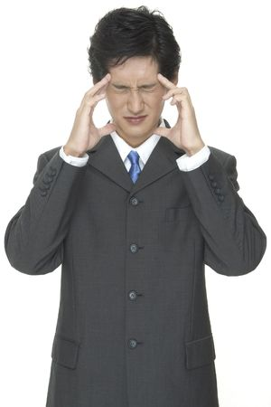 blue grey coat: An asian businessman is frustrated Stock Photo