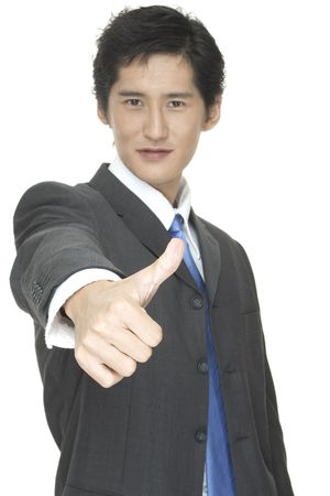 An asian businessman gives the thumbs up photo