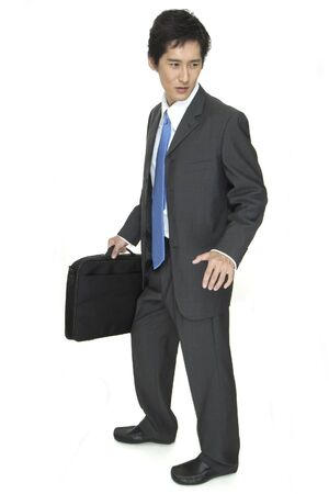 indecisive: An indecisive asian businessman in grey suit Stock Photo