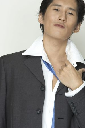 undone: An asian businessman with collar undone and tie loose