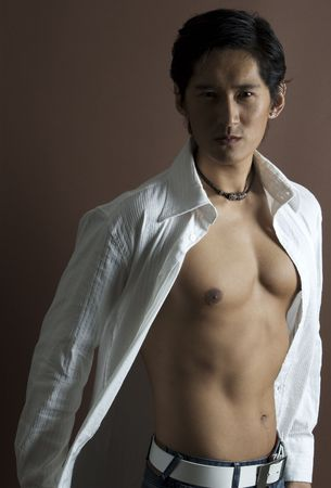 bare chest: A cool asian model in an open white shirt