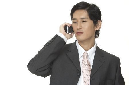 important phone call: An asian businessman makes an important business phone call Stock Photo