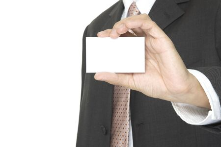 a businessman holds up a blank business card photo