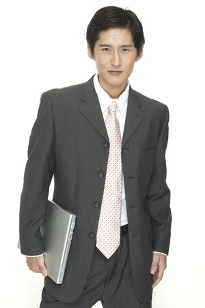 an asian businessman with a laptop computer photo