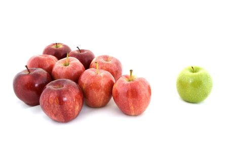 and distinctive: A green apple is separated from the rest