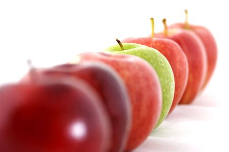 and distinctive: A green apple is the odd one out in a line of red