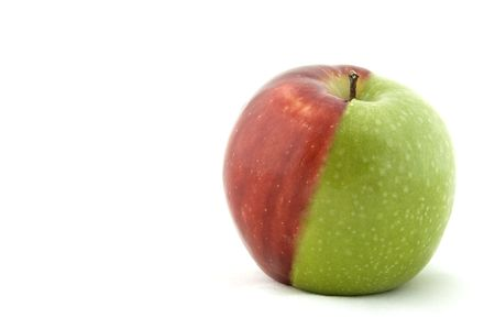 opposites: An apple made from half green and half red