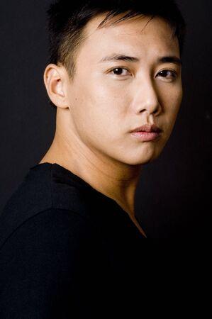 sidelight: An asian male model in black on black
