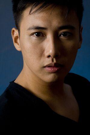 sidelight: A moody portrait of an asian male model in black