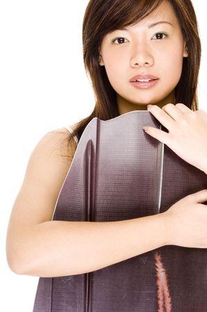 mujer china: Una mujer china joven bonita se presenta con un wakeboard