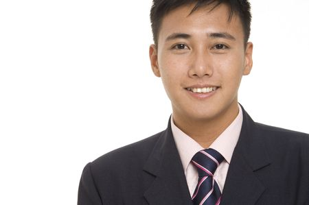 A young asian businessman in a sharp navy blue suit with matching pink shirt and tie Stock Photo - 235369