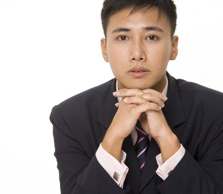 A good-looking asian businessman in suit, shirt and tie photo