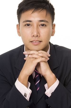 A young asian businessman in navy suit, pink shirt and matching tie photo