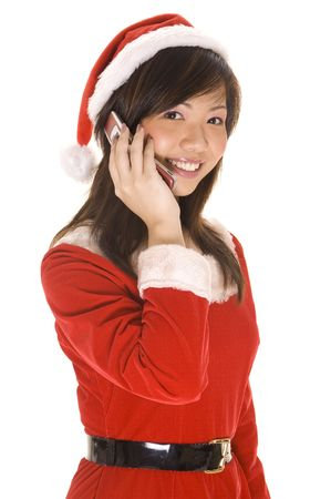 talks: A cute asian woman in a santa costume talks on a cellphone Stock Photo