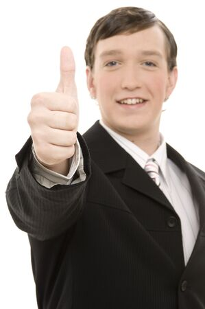 A young businessman in a dark suit and tie gives a thumbs up Stock Photo - 243494