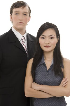 A businessman in dark suit stands next to a beautiful asian woman in a business suit Stock Photo - 243496