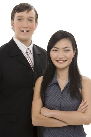 handsom: A businessman stands with a businesswoman, both wearing smart pinstriped suits